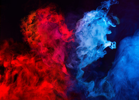 Photo pour abstract shapes of red and blue smoke in heart shape at dark background - image libre de droit