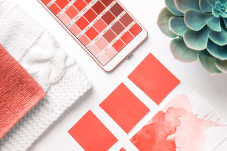 Photo for Color Palette Guide in mobile phone on White Background. flatlay. Color of the year 2019 Living coral. livingcoral - Royalty Free Image