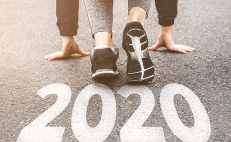 Photo pour girl in sports uniform running around. Healthy way of life, an infused figure. sneakers close-up, finish 20189 Start to new year 2020, plans, goals, objectives. - image libre de droit