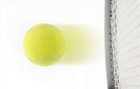 Fast speeding tennis ball being hit by a raquet suggesting a winner in a match