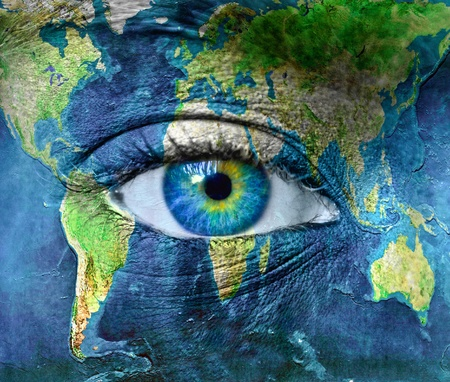 Photo pour Planet earth and blue hman eye - image libre de droit