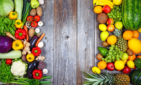 Foto für Huge group of fresh vegetables and fruit on wooden background - Vegetables VS Fruit - High quality studio shot - Lizenzfreies Bild