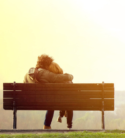 Photo for Romantic couple on bench - Royalty Free Image