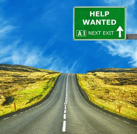 Photo for HELP WANTED road sign against clear blue sky - Royalty Free Image