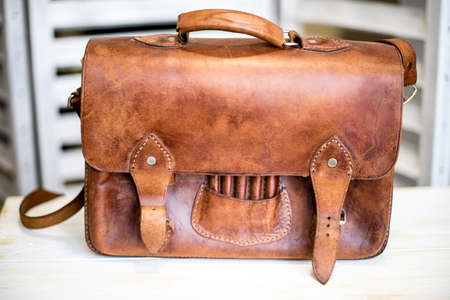 Photo for Brown Vintage leather briefcase with strap and brass buckle - Royalty Free Image