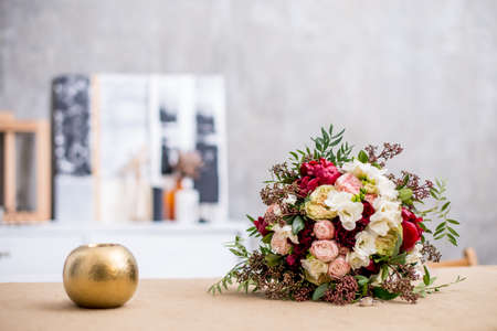 Photo for beautiful modern wedding bouquet on the table. Against the gray wall - Royalty Free Image