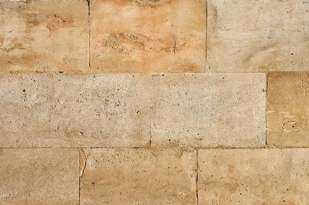 Old weathered stone tiles wall vintage background