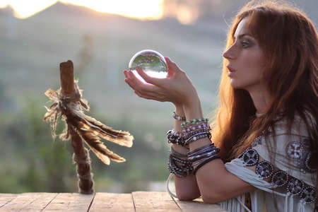 Photo pour witch with crystal ball at sunset - image libre de droit