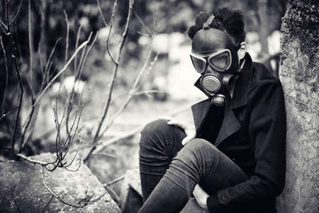 Photo for The guy in the coat and gas mask. - Royalty Free Image