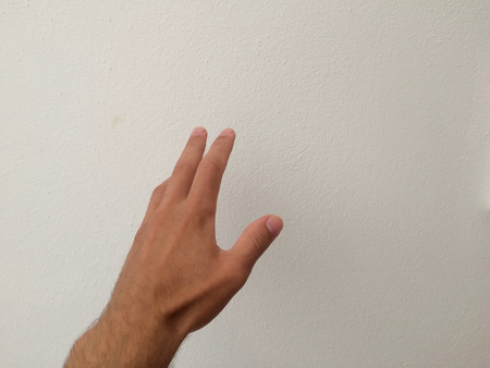Foto de outstretched palm, hand on a white background, back of the hand, part of the body, part of the hand, hair on the hand, white skin - Imagen libre de derechos