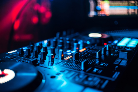 Photo for control buttons and mixing music on professional equipment for mixing DJ - Royalty Free Image
