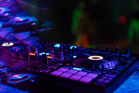 Photo for music mixer DJ controller in booth at nightclub party - Royalty Free Image