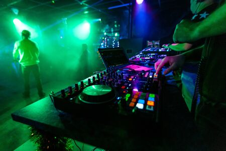 Photo for professional music mixer Board with the hands of a DJ at a party - Royalty Free Image