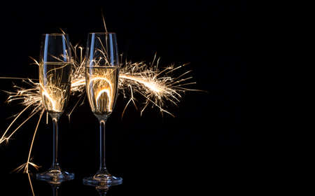 Photo for Two glasses of champagne in Bengal lights - Royalty Free Image