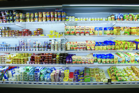 Photo for yogurts sour cream and others dairy produce on the shelves of shop - Royalty Free Image