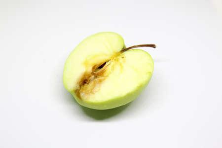 Foto de rotten green apple isolated over a white background - Imagen libre de derechos