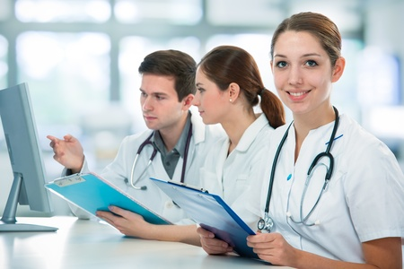 group of medical students studying in classroom