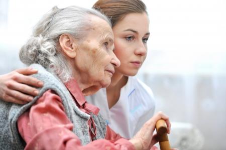 Photo pour Senior woman with her caregiver at home - image libre de droit