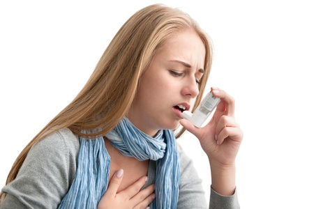 Photo for Young woman using an asthma inhaler as prevention - Royalty Free Image