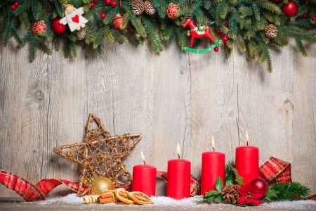 Foto de christmas decoration background with four advent candles burning - Imagen libre de derechos