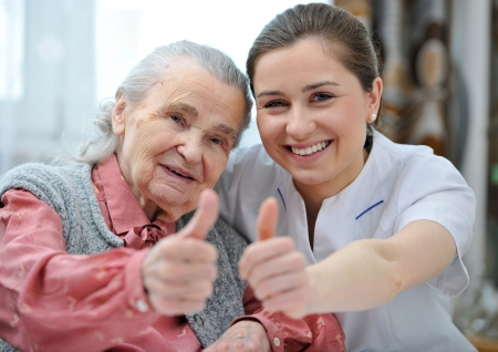 Photo for Senior woman and female nurse are showing thumbs up - Royalty Free Image