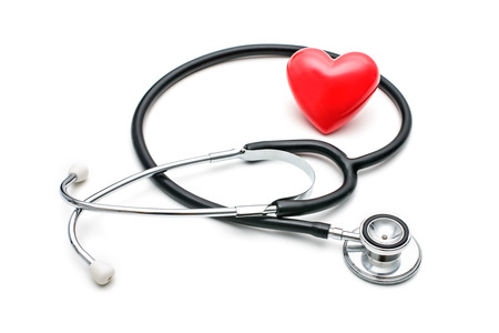 Foto de A  heart with a stethoscope  isolated on white background - Imagen libre de derechos