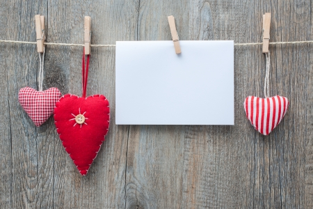 Photo for Message and red hearts on the clothesline against wooden  - Royalty Free Image