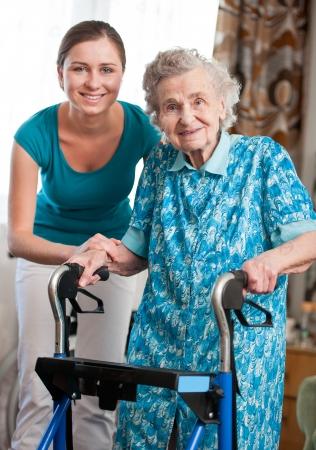 Foto de Senior woman with her caregiver at home - Imagen libre de derechos