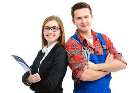 Foto de Apprentice handyman and office woman isolated on white background - Imagen libre de derechos