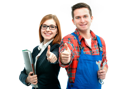 Foto de Apprentices for handyman and office showing thumbs up. - Imagen libre de derechos