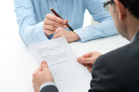 Photo pour Man signs purchase agreement for a  house - image libre de droit
