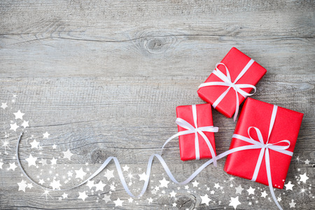 Photo for Gift boxes with bow and snowflakes on wooden background - Royalty Free Image
