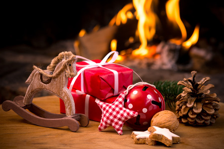 Photo for Christmas scene with tree gifts and fire in background - Royalty Free Image