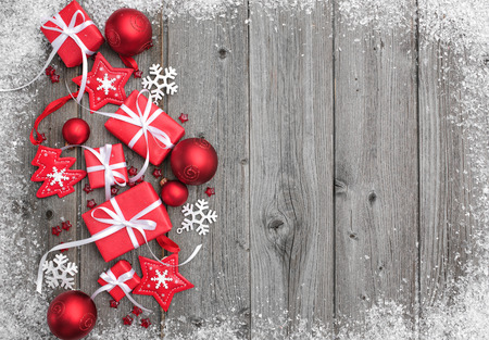 Photo for Gift boxes and snowflakes on wooden background - Royalty Free Image