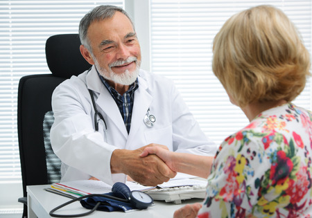 Photo for Doctor shaking hands to patient in the office - Royalty Free Image