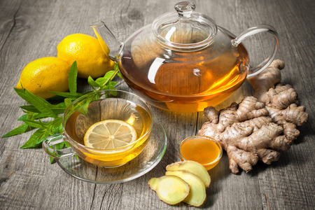 Photo for Cup of ginger tea with honey and lemon on wooden table - Royalty Free Image