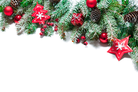 Fir tree branches with christmas decoration isolated on white background
