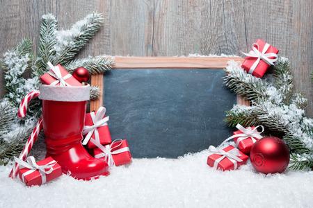 Foto de Vintage Christmas decoration with chalkboard for message - Imagen libre de derechos