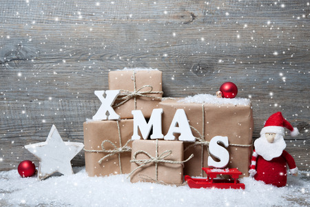 Photo pour Christmas background with gift boxes over wooden board - image libre de droit