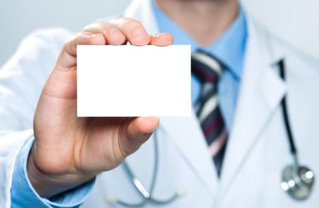Foto de Doctor showing his business card - Imagen libre de derechos