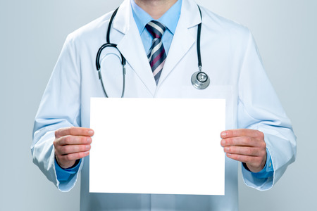 Photo for Doctor holding blank white banner - Royalty Free Image