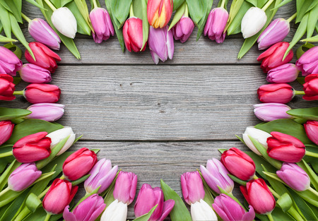 Photo for Frame of fresh tulips arranged on old wooden background - Royalty Free Image