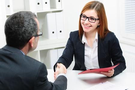 Foto de Job applicant having interview. Handshake while job interviewing - Imagen libre de derechos