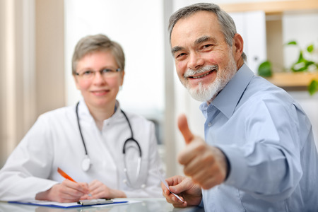 Photo for Happy senior patient and doctor at the doctor's office - Royalty Free Image