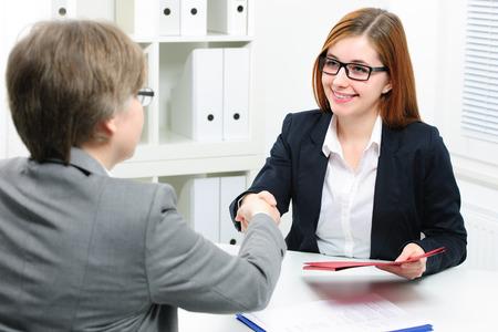 Photo pour Job applicant having interview. Handshake while job interviewing - image libre de droit
