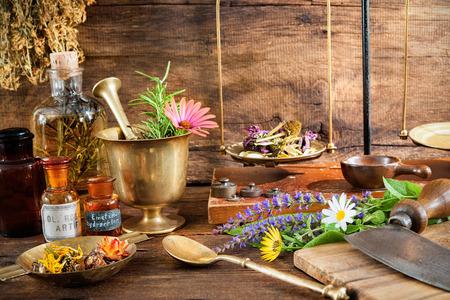 Photo pour Ancient natural medicine, herbal, vials and scale on wooden background - image libre de droit