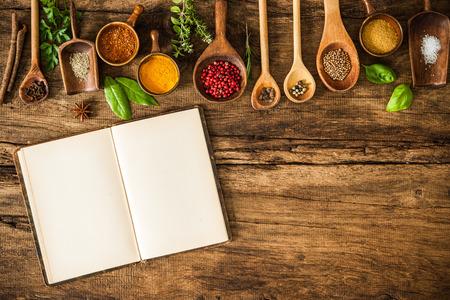 Foto de Blank cookbook and spices on wooden table - Imagen libre de derechos