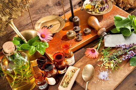 Photo for Ancient natural medicine, herbal, vials and scale on wooden background - Royalty Free Image