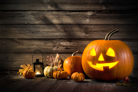 Foto de Halloween pumpkin head jack lantern on wooden background - Imagen libre de derechos