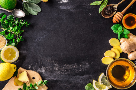 Photo for Ingredients for ginger tea with lemon and honey on slate plate - Royalty Free Image